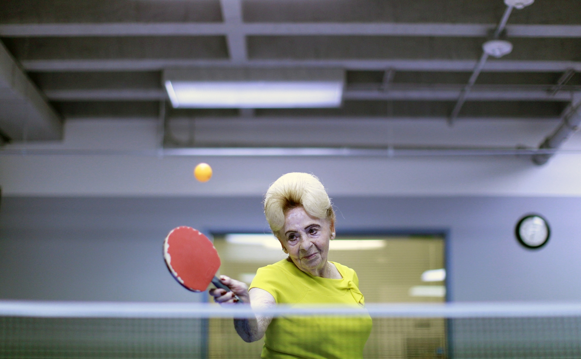 Lucy Nicholson (American/British, born England). Alzheimer's Ping Pong Therapy, Los Angeles, CA, 2011, printed 2016. Inkjet print, 10 5/8 x 16 3/8 in. (26.9 x 41.5 cm). Courtesy of Lucy Nicholson/Reuters