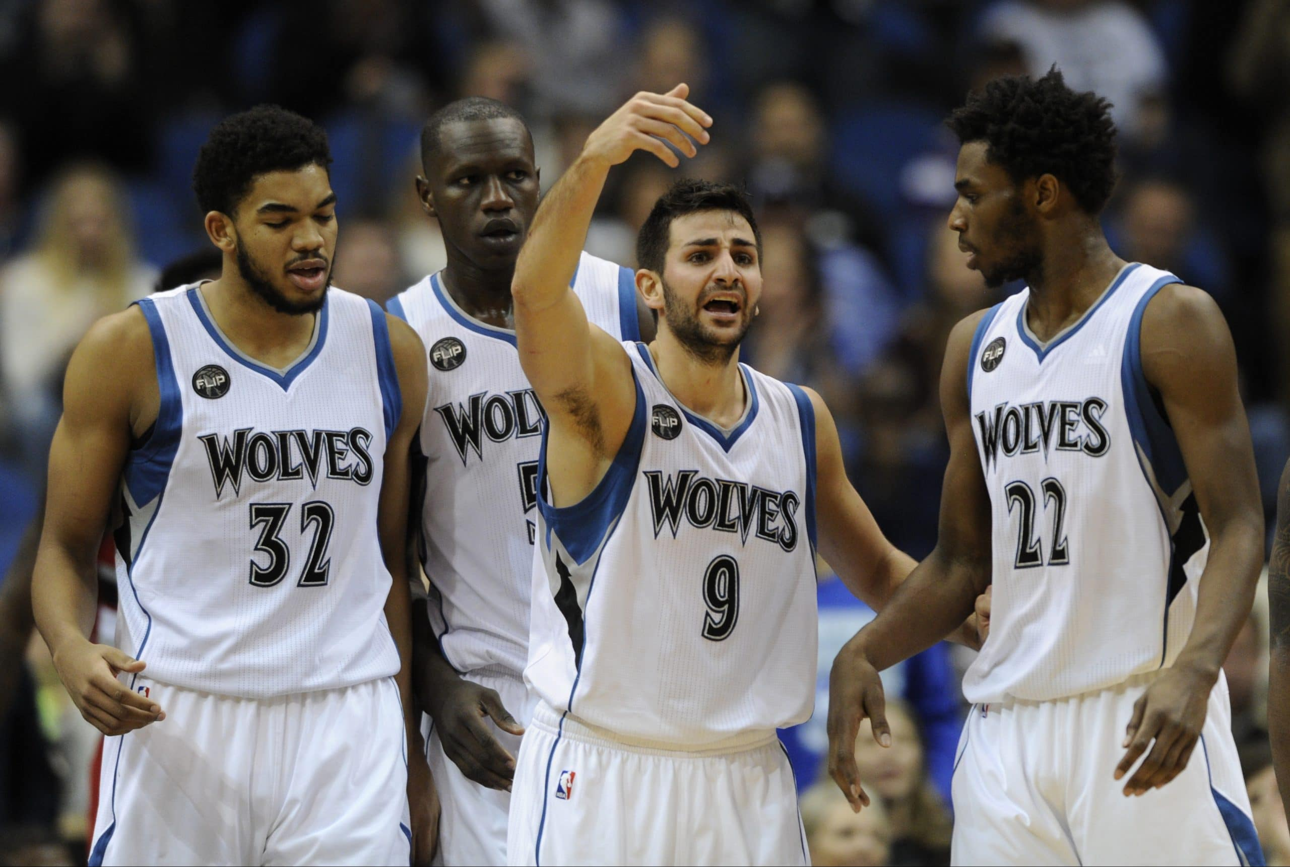 Minnesota Timberwolves center Karl-Anthony Towns (32), left, center Gorgui Dieng (5), of Senegal, guard Ricky Rubio (9), of Spain, and guard Andrew Wiggins (22) huddle up during the fourth quarter of an NBA basketball game against the Portland Trail Blazers on Saturday, Dec. 5, 2015, in Minneapolis. The Trail Blazers won 109-103. (AP Photo/Hannah Foslien)