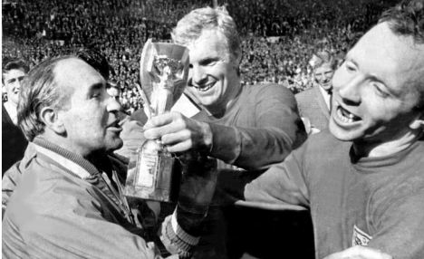 Football world cup final 1966 England v West Germany (4-2) l to r.manager Sir Alf Ramsey, Bobby Moore and Nobby Stiles with world cup trophy after england's win